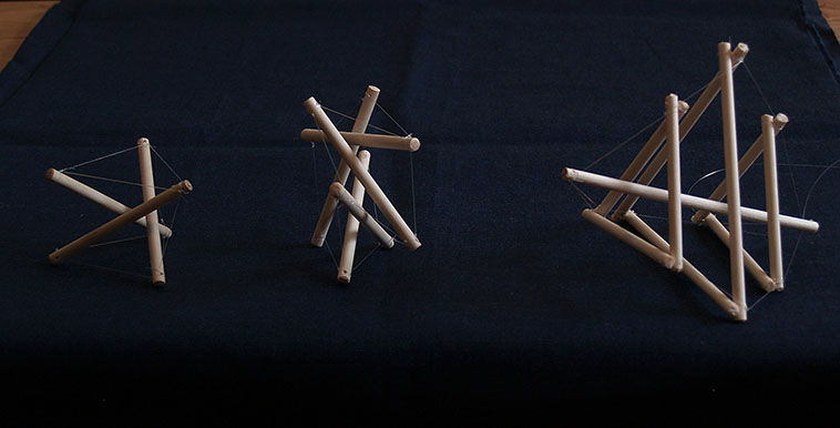 small sculptures made from wood dowels and fishing line